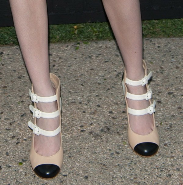 Emma Roberts shows off the interesting neutral color palette of her Chanel heels