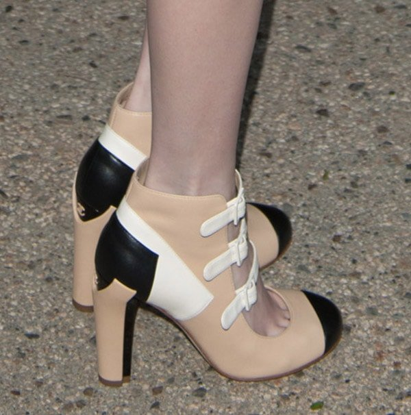 Emma Roberts shows off a pair of Chanel heels from the brand's Spring 2013 collection