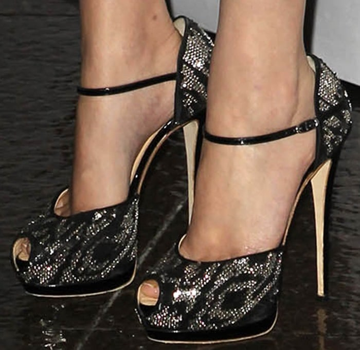 Emma Watson wearing glittery sky-high ankle-strap sandals that made her gams look extra long