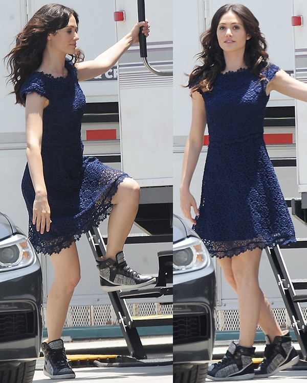 Emmy Rossum wearing a blue dress on the set of Comet