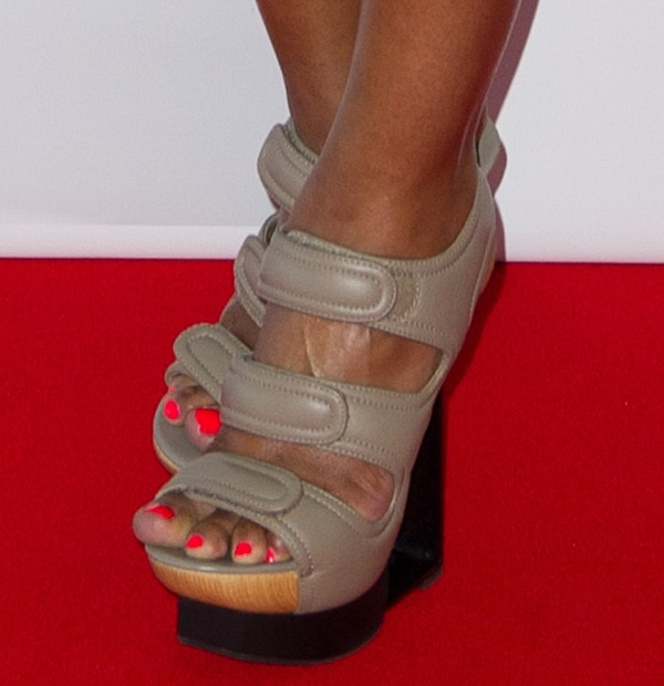 Eve's toes peeping out of 90 Degrees Space gladiator sandals by United Nude