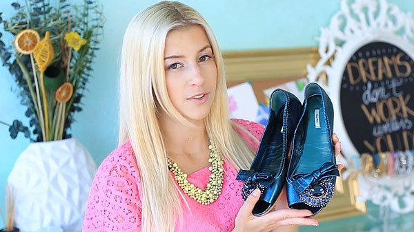 Fashion blogger Evelina Barry of Evelina's Fashion Cafe showing the Miu Miu flats she almost had to pass up because they were too big