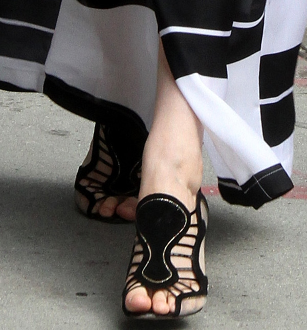 Greta Gerwig shows off her feet and the detailing on her Nicholas Kirkwood sandals