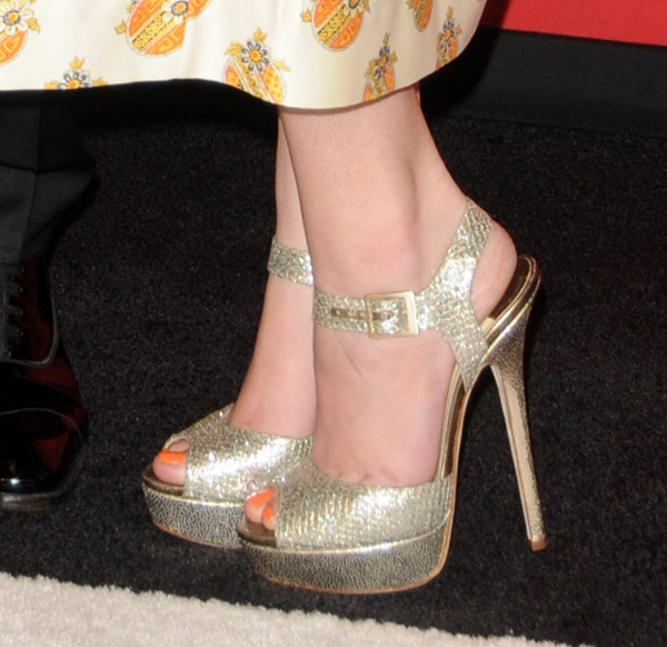 Hailee Steinfeld poses in a pair of sparkly Jimmy Choo sandals