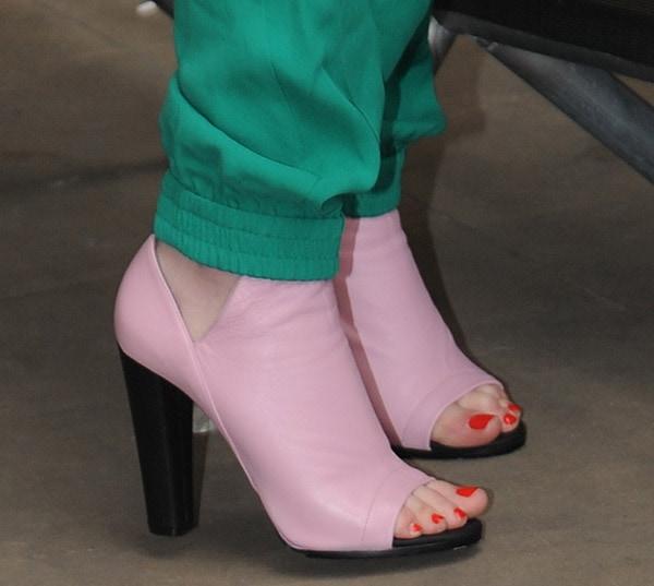 "Iggy Azalea wears a pair of ""Revers"" booties in pink"