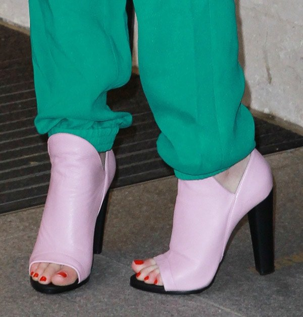 Iggy Azalea finishes up her outfit with a pair of pastel pink Balenciaga booties and a red pedicure