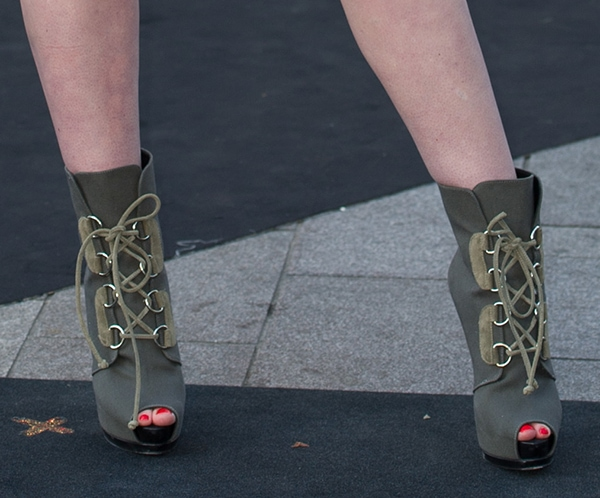 Iggy Azalea showing off her legs in Giuseppe Zanotti boots