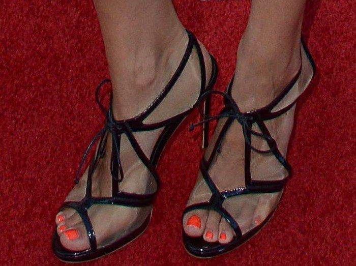 Jaimie Alexander's feet in black-and-mesh heels