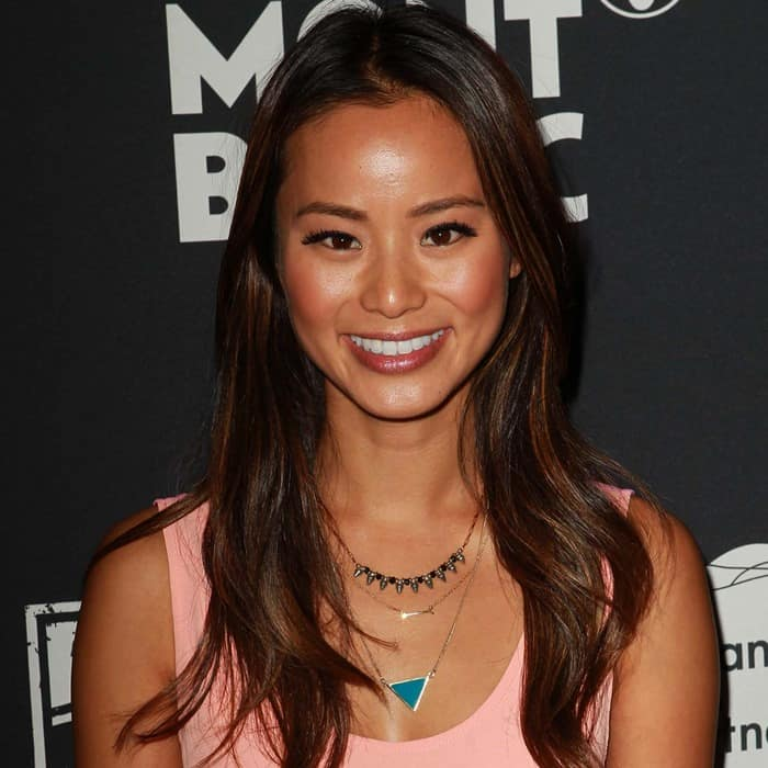 Jamie Chung showing off herStella & Dot On the Mark necklace