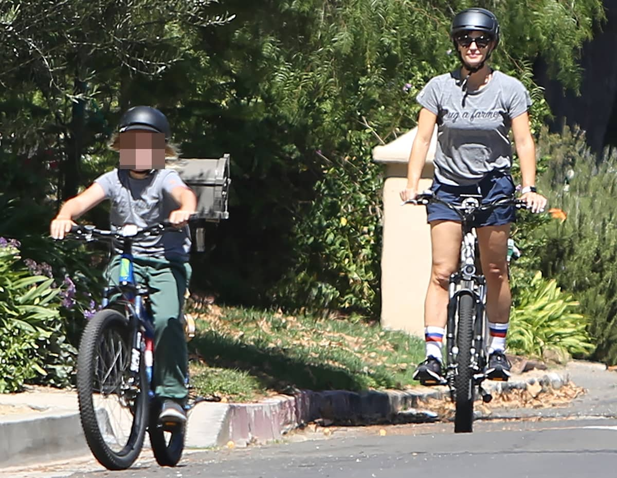 Wearing Brooks Levitate 4 sneakers and a The Uplifters Hug a Farmer tee, Jennifer Garner goes for a bicycle ride with her son Samuel Affleck