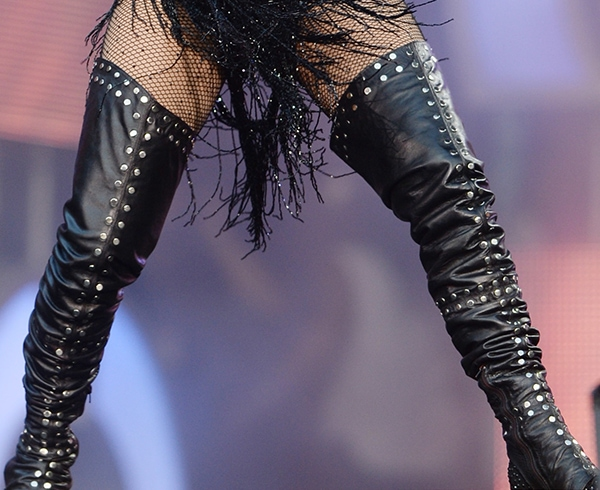 Jennifer Lopez wears a pair of studded thigh-high leather boots on stage