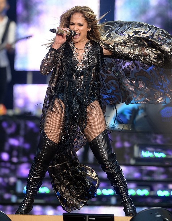 Jennifer Lopez gives it her all on stage as she performs in a fringed outfit and leather thigh-high boots