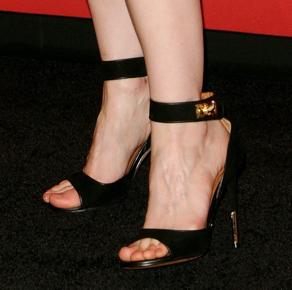 Jessica Chastain shows off her feet in Givenchy sandals with gold detailing