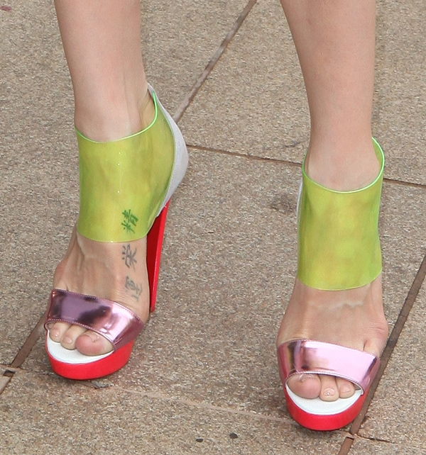 Jessica Stam's foot tattoo peeks out from beneath her multicolored Christian Louboutin sandals