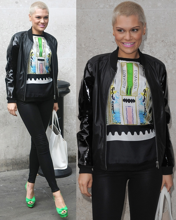 Jessie J rocking leather pants paired with a bomber jacket with leather patent sleeves over a sleeveless graphic top