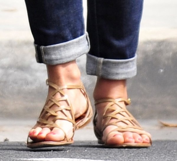 Jordana Brewster sported a pair of patent leather Amalie cage sandals by Tory Burch