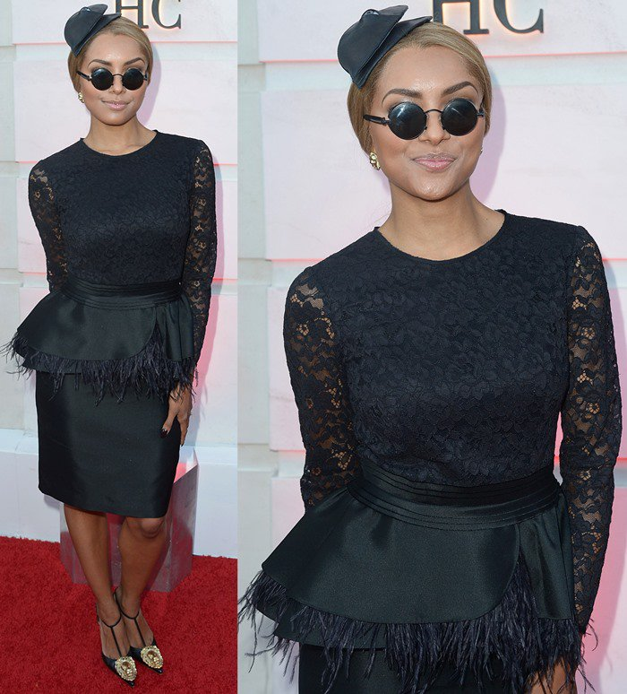 Katerina Graham wears a black feathery look with a fascinator to the opening of the Beverly Hills Carolina Herrera store
