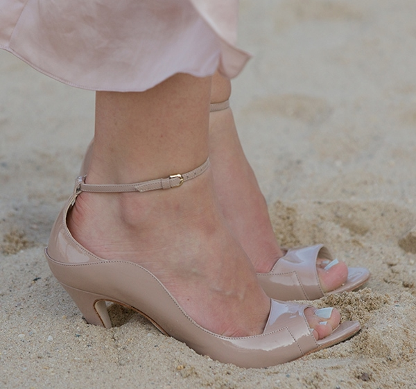 Closeup photos of Katharine McPhee's Brian Atwood heels digging in the sand