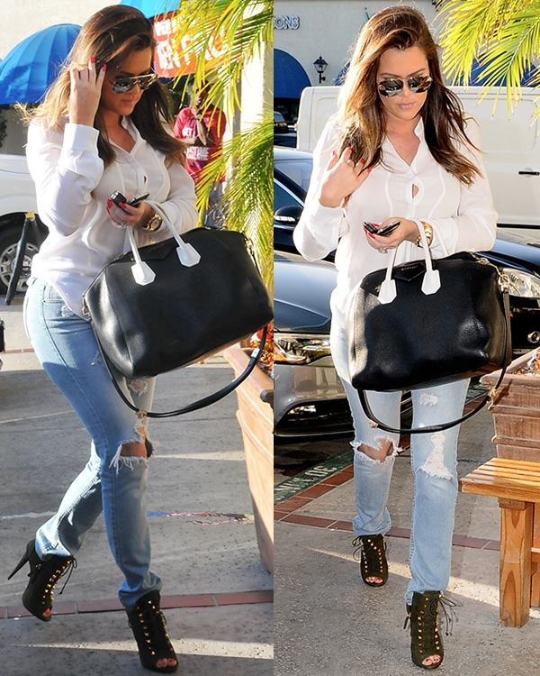 Khloe Kardashian in a white long-sleeved top and tattered jeans