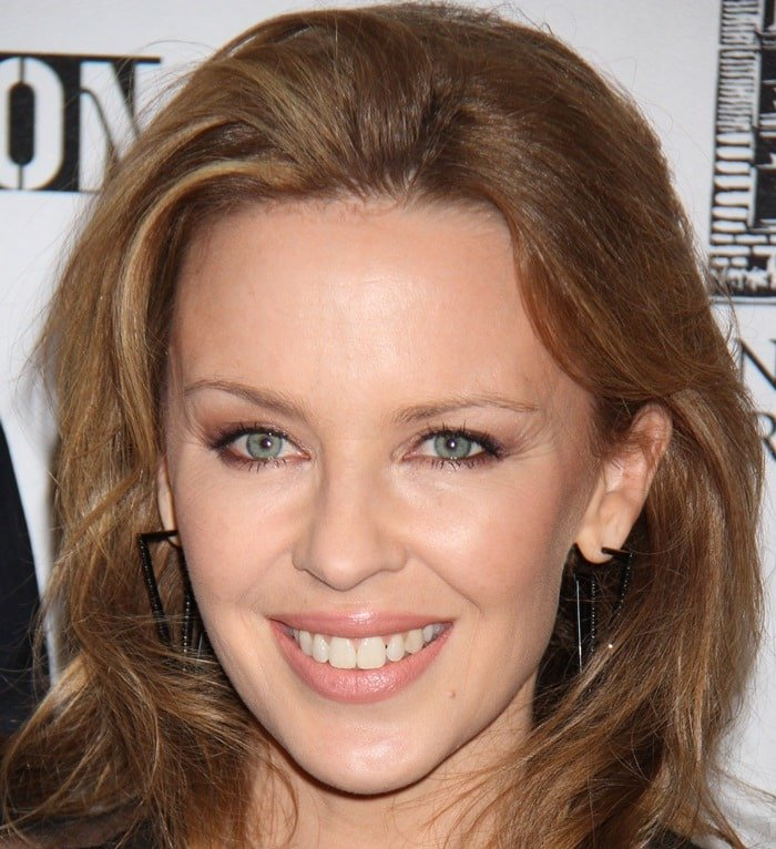 Kylie Minogue'sswept-back hair and glowing skin