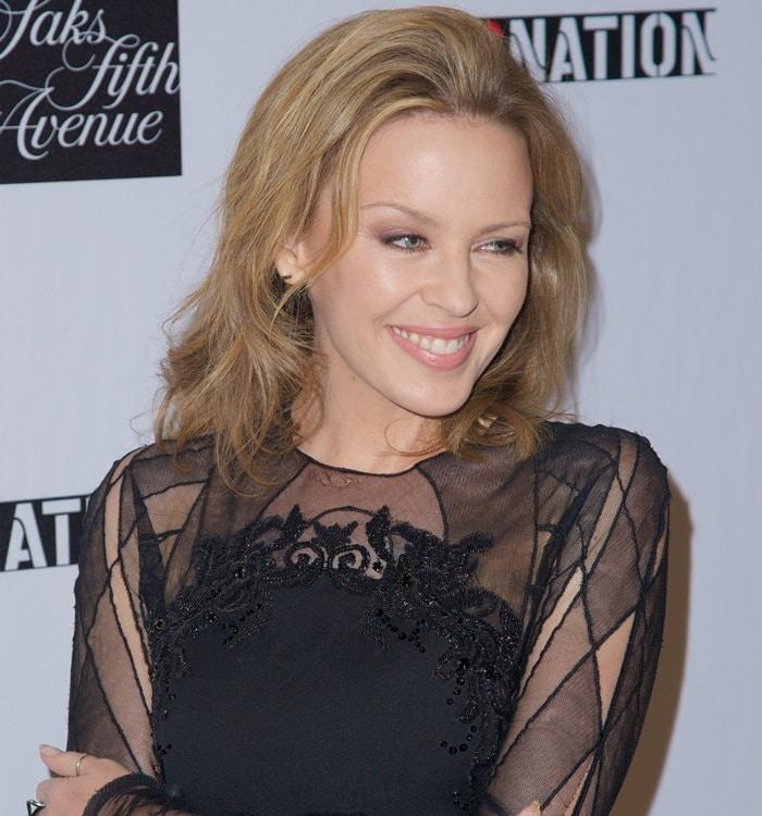 Kylie Minogue wearinga black Emilio Pucci mini-dress with sheer panels