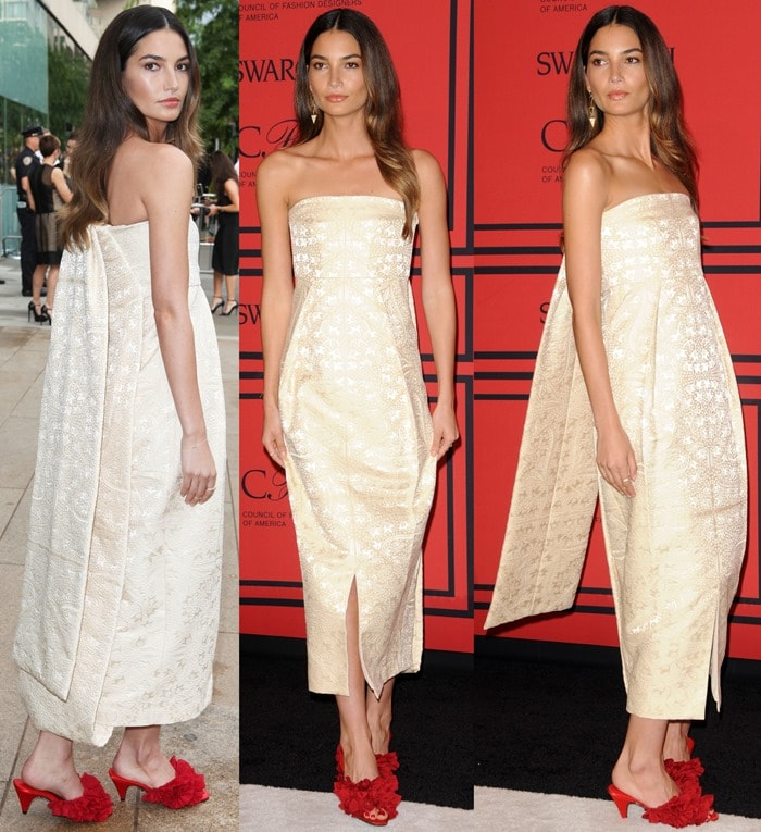 Lily Aldridge in a loose white wrap dress and granny slippers