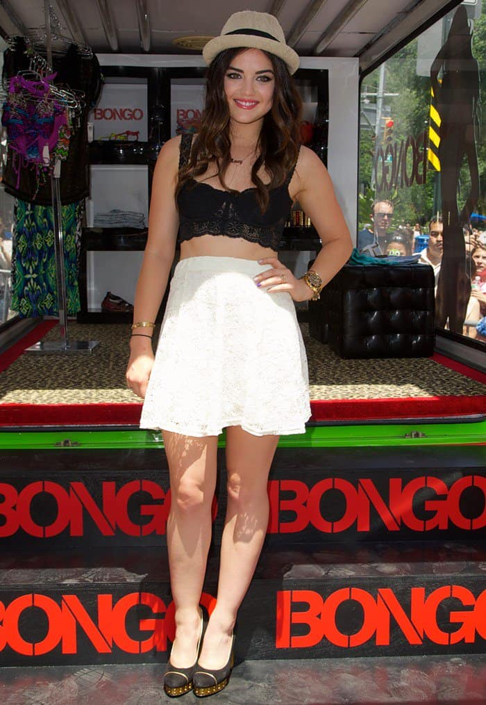 Lucy Hale donning a cropped lace top and a doily-inspired white skirt