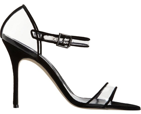 Slick patent frames the cool translucence of a modern-classic pump perched atop a slim, wrapped heel