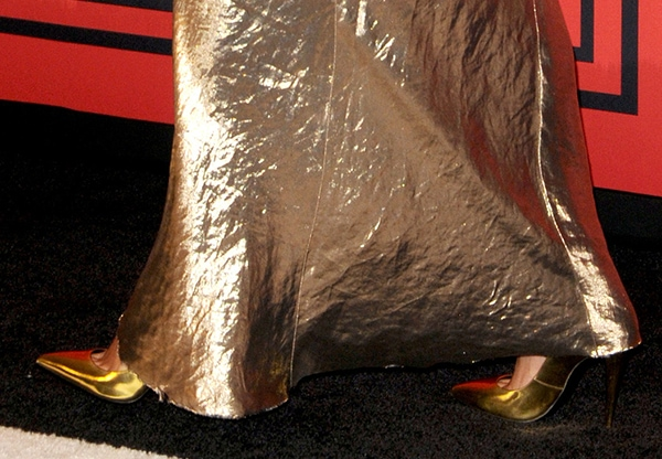 Nicole Richie's metallic Marc Jacobs pumps peek out from beneath her gown