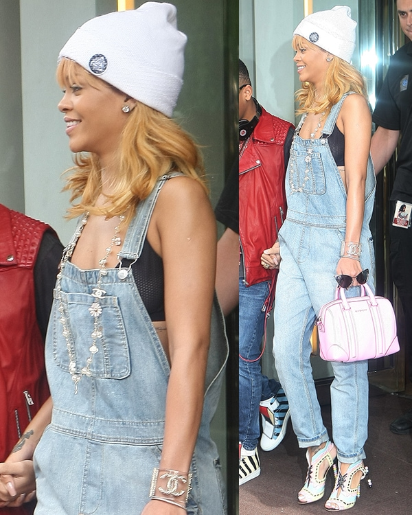 Rihanna wearing blue denim overalls paired with a black bralette