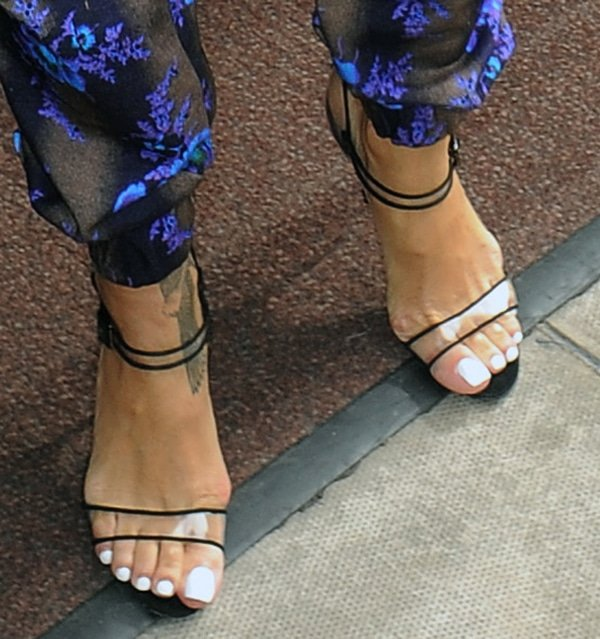 Rihanna showing off her feet in Fersen see-through Mary Jane sandals