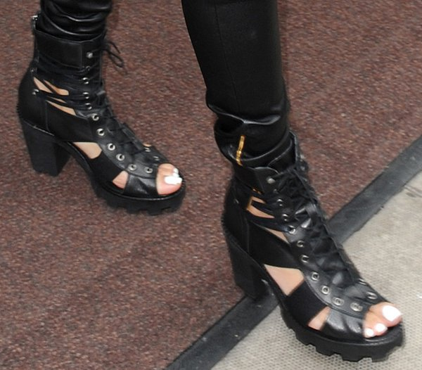Rihanna styled her ankle boots with leather leggings