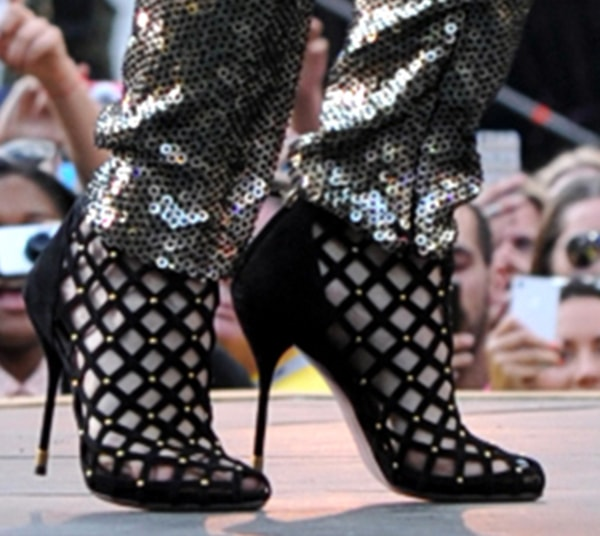 Rita Ora performs on stage in a pair of Gucci booties