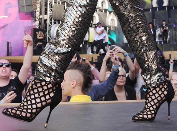 """Rita Ora wears a pair of latticework """"Isabel"""" booties during her stage performance"""