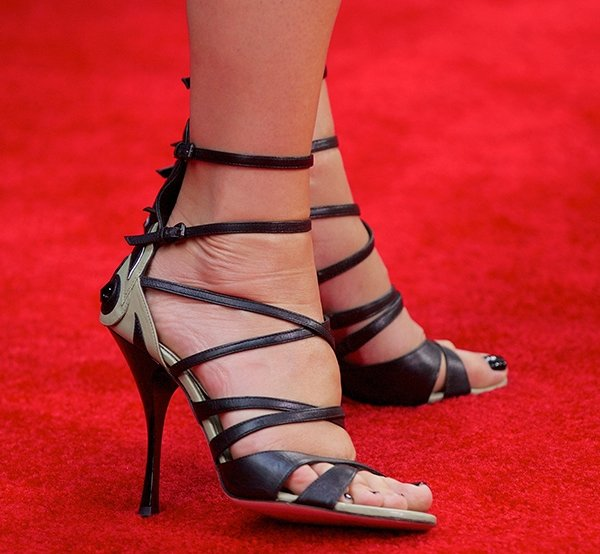 Sandra Bullock's sexy toes in sandals with patchwork detail on the back heels