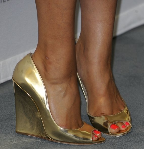 Shay Mitchell's sexy toes in golden Biel wedges