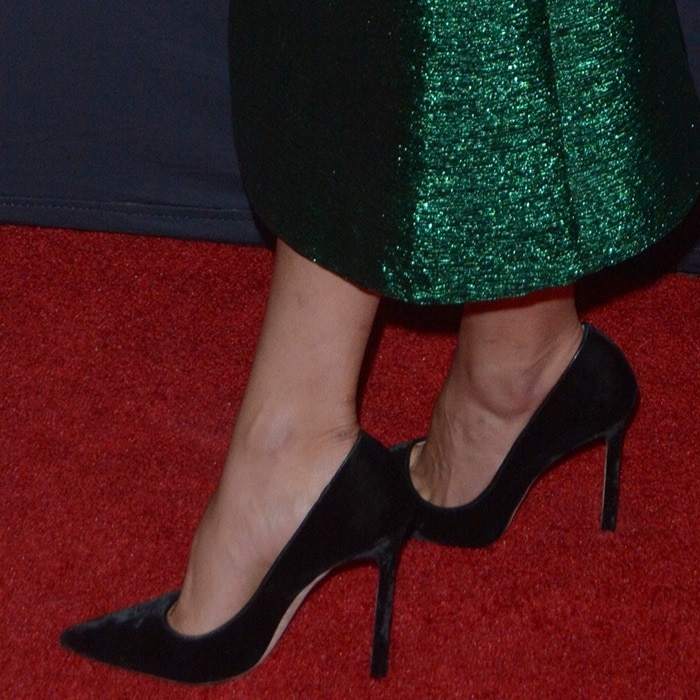 Shay Mitchell showed off her pretty feet in black pointy-toe pumps