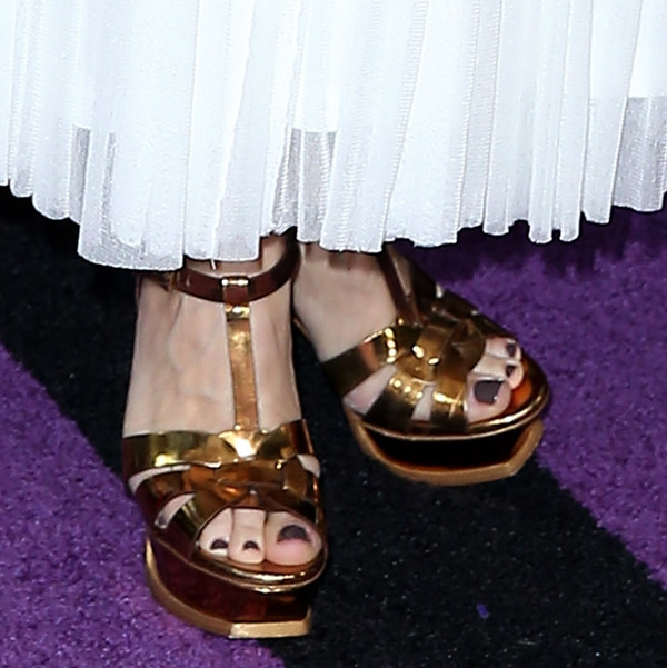 Sheryl Crow wearing gold Tribute platforms by YSL