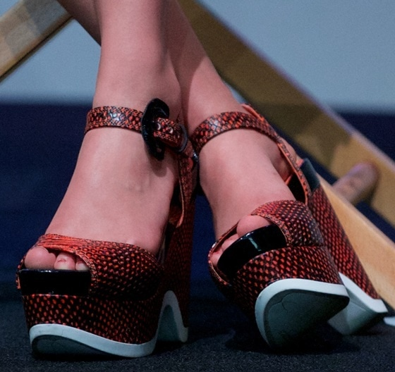 AnnaSophia Robb shows off her feet in textured wedges withbright orange spots