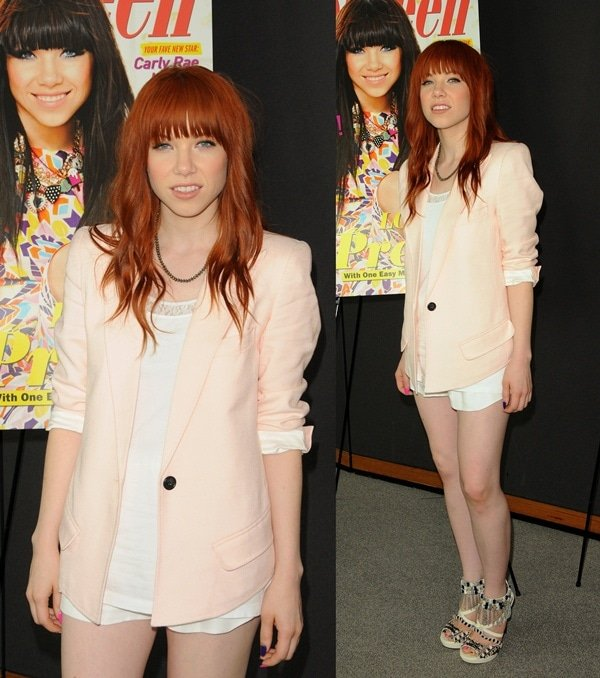 Carly wore teeny white shorts with a white tank layered beneath a pearly pink Smyth jacket