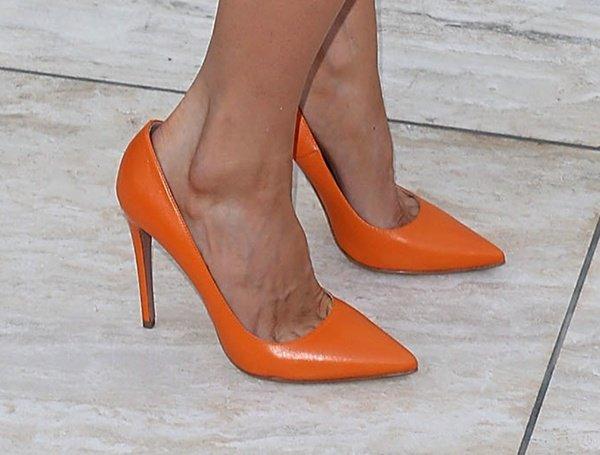 Jaime Murray in orange Prada pumps
