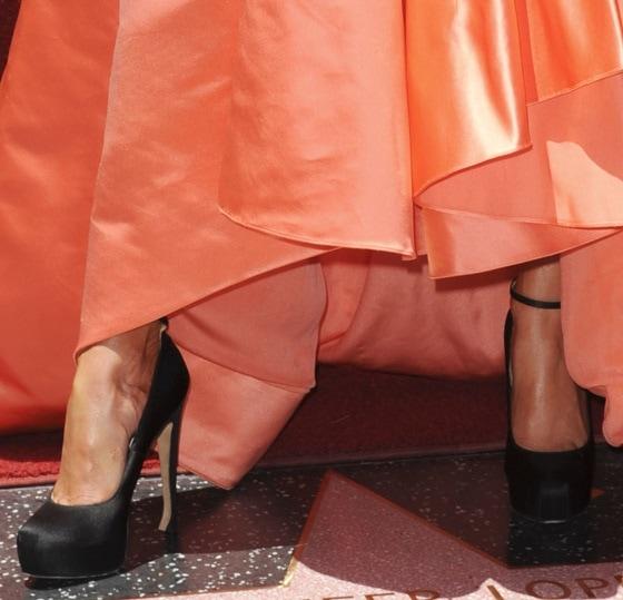 Jennifer Lopez wearingankle-strap pumps in satin black