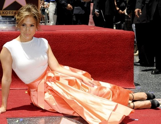 Singer and actress Jennifer Lopez poses on her star after it was unveiled on the Walk of Fame in Hollywood, California June 20, 2013