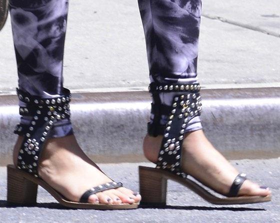 Food critic Katie Lee wearing Isabel Marant's 'Caroll Elvis' heeled cuff sandals