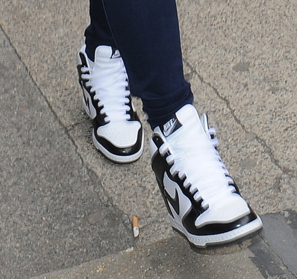 Nicole Scherzinger wearing black-and-white Nike Dunk Sky Hi hidden wedge sneakers