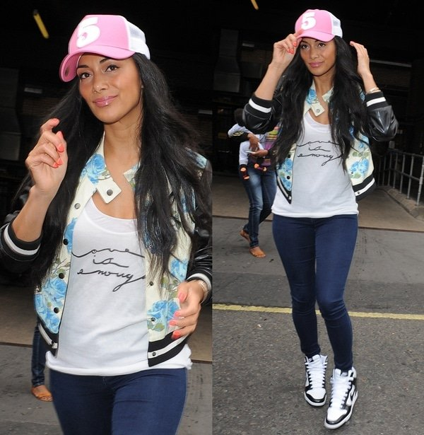 Nicole Scherzinger was spotted looking quite comfy in skinny jeans, a white tee, and a floral-printed 'Turning Rose' varsity jacket from Mural