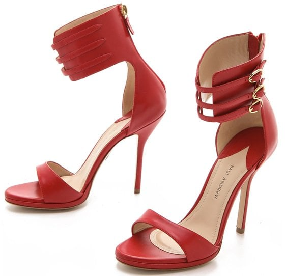 A sexy pair of heeled sandals from Paul Andrew harnesses the ankle with thin straps on a high cuff