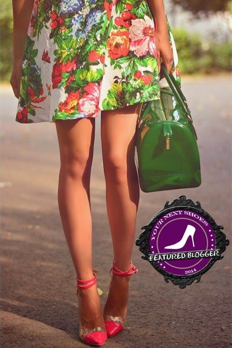 Paris pairing a green printed dress with pink Voleta ankle-strap pumps