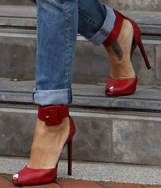 Rihanna showing off her feet in Saint Laurent Paris ankle-cuff sandals