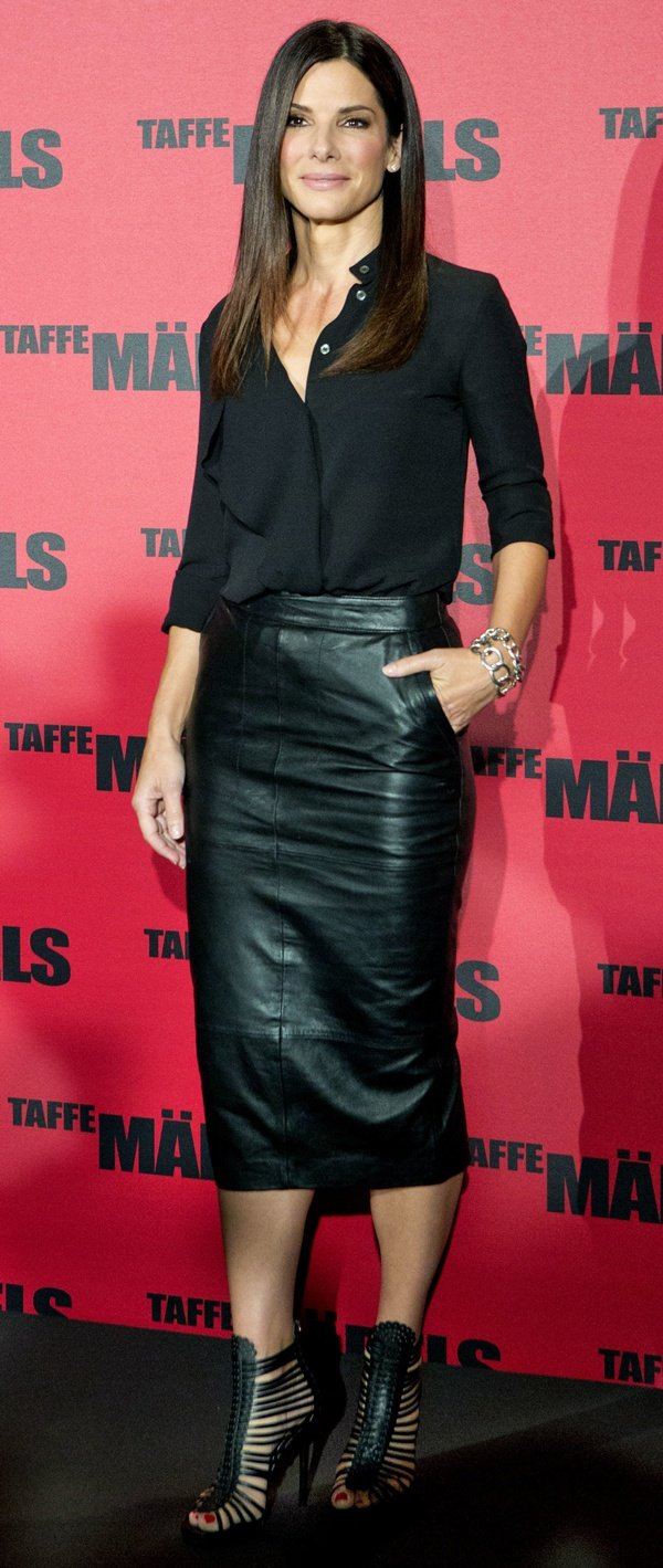 Sandra Bullock wearing a billowy Michael Kors blouse, an ASOS pencil skirt, and killer Tabitha Simmons sandals